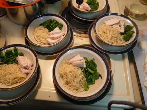 More soup: chicken, Chinese broccoli, egg noodles awaiting broth, poached eggs and sriracha