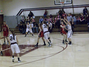 IMS' Kristin Davis going for a 3-point shot against Highland.