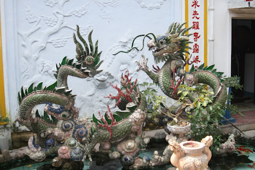 Many ornate and detailed statues decorate the inside of temples and houses throughout Hoi An.