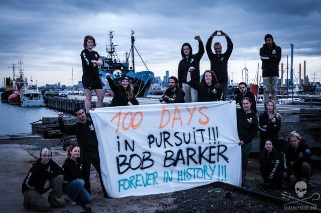 Sea Shepherd activists hold a sign that reads, '100 Days In Pursuit! Bob Barker forever in history!'. The pursuit of the pirate poaching ship 'Thunder' by Sea Shepherd ship the Bob Barker has lasted 100 days, as of 27 March 2015. Photo: Sea Shepherd Conservation Society