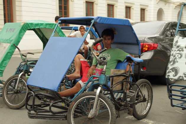 A pedi cab driver in the intra muros area of Manila, Philippines