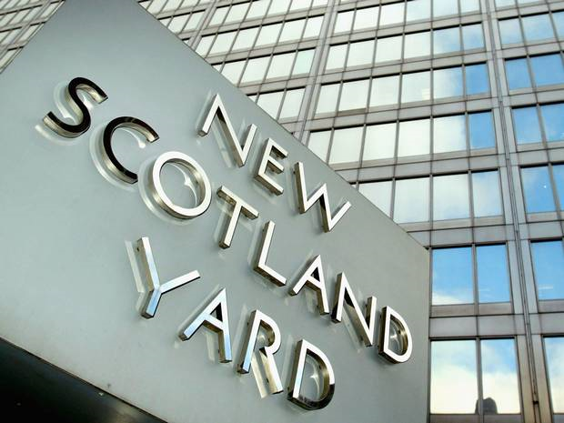 Sign in front of the New Scotland Yard headquarters. Photo: The Independent