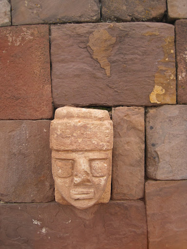 Detail of one of the carved heads, notice the block above it which appears to have a representation of South America on it.