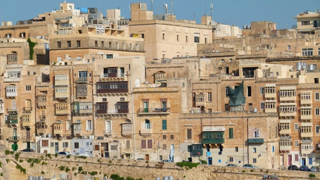 A backdrop of old Maltese houses in the Grand Harbour