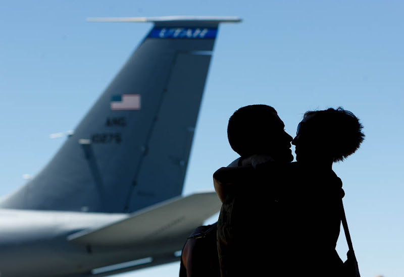 Mickaela Hawkley embraces her husband Bleu as the soldiers from the Utah Army National Guard's Second Battalion, 211th Aviation unit returned from a 12-month deployment to Afghanistan.