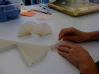 Here we're making mini pleated items to include in the opening shot.