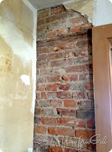 Plaster Wall with Exposed Brick
