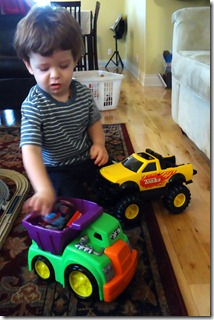saylor playing with plastic dump truck