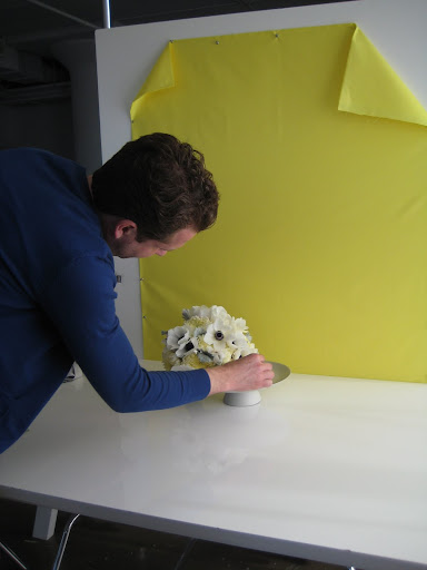 Matthew places the bouquet on set.