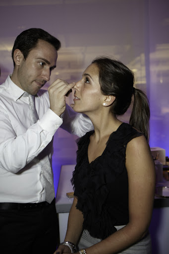 Here, Estee Lauder national makeup artist, Derek Miller, touches up one lucky lady.