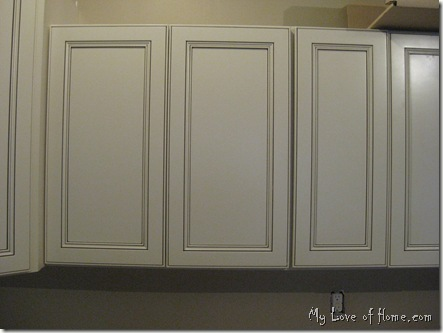 Soft white cabinet with chocolate glaze