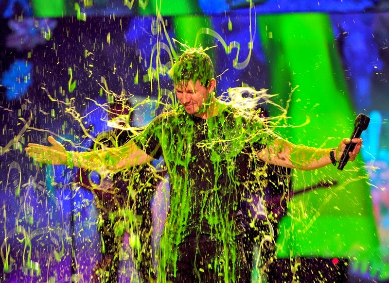 LOS ANGELES, CA - MARCH 29:  Host Mark Wahlberg gets slimed onstage during Nickelodeon's 27th Annual Kids' Choice Awards held at USC Galen Center on March 29, 2014 in Los Angeles, California.  (Photo by Frazer Harrison/KCA2014/Getty Images)