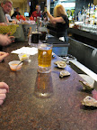 It was a perfect late lunch: plastic mugs of beer, oysters plopped right on the counter, and a setup to make your own cocktail sauce.