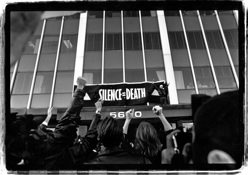 """Silence=Death"" banner raised on the Food and Drug Administration (FDA) offices protesting the slow drug approval process. October 11, 1988."