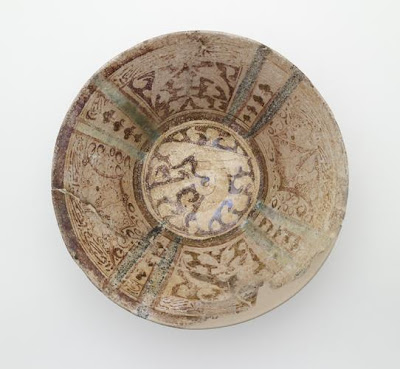 Bowl | Origin:  Syria | Period: 12th-13th century  Ayyubid period | Details:  Not Available | Type: Stone-paste; decorated with lustre | Size: H: 11.6  W: 23.6  cm | Museum Code: F1908.149 | Photograph and description taken from Freer and the Sackler (Smithsonian) Museums.