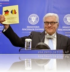 German Foreign Affairs Minister Steinmeier holds brochure with German flag superimposed on French border