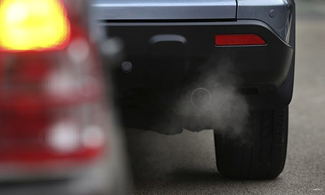 Exhaust fumes from a car. Babies born to mothers who live in areas with air pollution and dense traffic are more likely to have a low birthweight and smaller head circumference, according to a large European study in 2013. Photo: Peter Macdiarmid / Getty Images