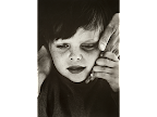 Autistic boy and carer. <em>© Anthony Browell</em>
