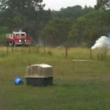 June 6, 2011 - VFD putting out the fire caused by lighting that set fence post on fire and the field next to the blueberry orchard