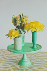 Consider placing three small vases together on a cake stand for added height.
