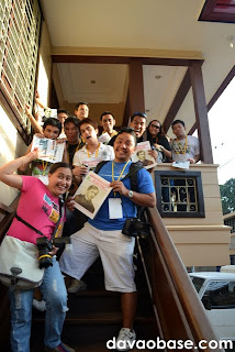 Wait, are those freebies you're all holding?!? Davao bloggers hamming it up at the Manila Bulletin office