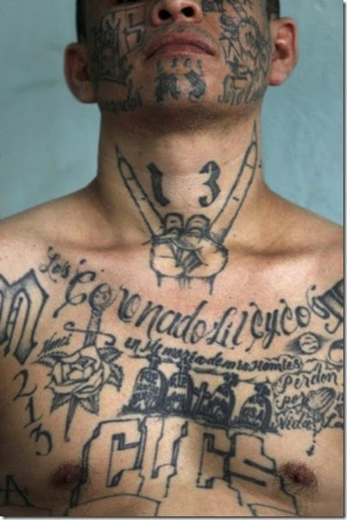 """""""El Recio"""" (The Tough One or The Hard One), 32, a former leader of the Mara Salvatrucha or M -13 gang, poses during a photo session at Comayagua jail in Honduras June 11, 2011. """"El Recio"""" has been in and out of jail since he was 12 and is currently serving a sentence for various crimes including murder, extortion and drug trafficking. As a former leader of a gang, he has tattoos on his face and other visible body parts indicating his rank in the gang and respect on the streets. REUTERS/Edgard Garrido        (HONDURAS - Tags: CRIME LAW) FOR EDITORIAL USE ONLY. NOT FOR SALE FOR MARKETING OR ADVERTISING CAMPAIGNS. HONDURAS OUT. NO COMMERCIAL OR EDITORIAL SALES IN HONDURAS"""