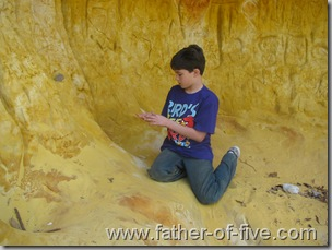 Sifting through the fine sand of the cave.