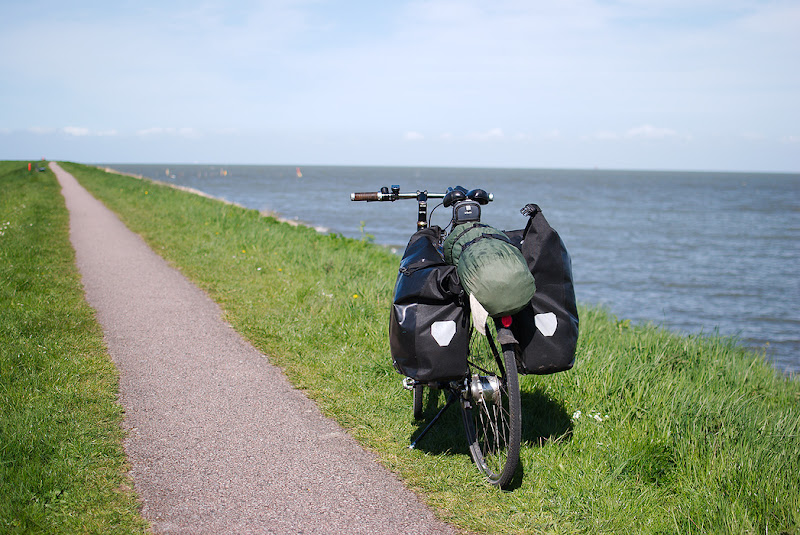 A straight bicycle path alongisde Zuidersee, near Amsterdam, Holland.