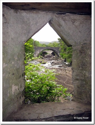 Looking up river through the Summer House windows at both bridges over the Invermoriston Falls.
