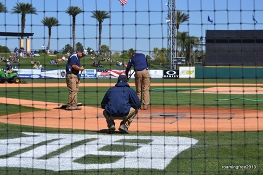 Groundskeepers get the field ready
