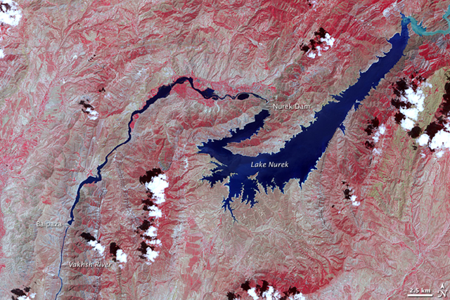 This false-color image shows the central part of the river, including the Nurek Dam and resulting reservoir. The image uses visible and near-infrared light to make the area's sparse vegetation stand out from the surrounding terrain. Vegetation is red, bare ground is tan, and water is blue. Upstream of Lake Nurek, at a sharp bend in the river, the waters are pale blue; the brightness comes from sediment. The image was captured by NASA's Terra satellite on 9 July 2007.