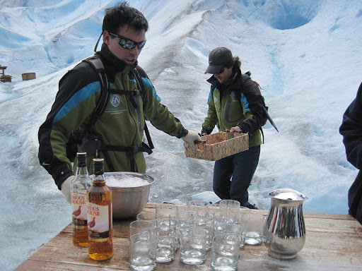 Our guides preparing whiskey on (glacial) ice.
