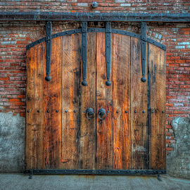 Clam Cannery Side Door by Bill Camarota - Buildings & Architecture Architectural Detail ( port, wood, door, rustic, iron,  )