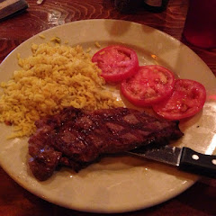 Steak, rice, tomatoes