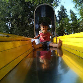 Happy Slides ! by Darshan Trivedi - Babies & Children Child Portraits ( child, enjoyment, happy, joy, slide, yellow, garden, kid,  )