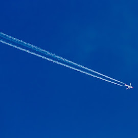 A high-flying jet leaving chemtrails ...  by Kishu Sing - Transportation Airplanes ( sky, airplanes, fly, airspace, lisbon, portugal )