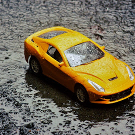 Braving the Monsoon ! by Anoop Namboothiri - Artistic Objects Toys ( water, car, water drops, raining, toy, monsoon, anoop namboothiri, automobile yellow, rain,  )