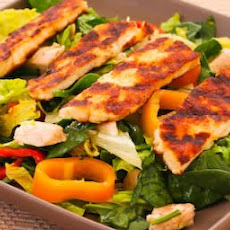 Grilled Halloumi Salad with Rotisserie Chicken, Mini Peppers, and Lemon