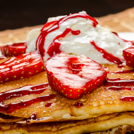 Vanilla and Strawberry Pancakes by Robert Machado - Food & Drink Candy & Dessert ( dish, breakfast, crepes, round, french, restaurant, homemade, baked, pancake, fresh, garnish, ice cream, cooking, pile, lunch, closeup, gourmet, dessert, meal, garnished, cake, fruit, beautiful, white, plate, traditional, delicious, blueberries, morning, snack, strawberry, sauce, close-up, dinner, shrovetide, nutrition, tasty, syrup, sweet, flapjack, color, food, healthy, thin, eat, stack, golden, sugar )
