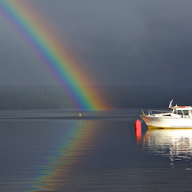 Rainbow Reflections by Venetia Featherstone-Witty - Transportation Boats ( lake reflections, rainbow reflections, waterscape, lake, travel, boat, rainbow, fishing boat, tourist destination,  )