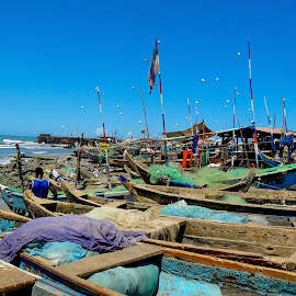 Waiting by Tomek Karasek - City,  Street & Park  Neighborhoods ( fishery, blue sky, boats, africa, accra )