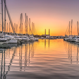 Sunrise over Pollença, Mallorca. by Liam Coburn Dunne - Landscapes Sunsets & Sunrises ( port, nikon 24-70, orange, dawn, pollença, nikon d800, boats, reflections, convergence, yellow, sunrise, masts,  )