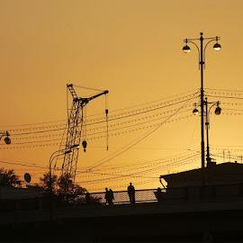 On the bridge by Vlad Sidorak - City,  Street & Park  Skylines ( sunset, street, silhouettes,  )