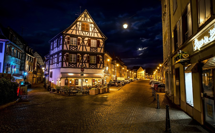 The Jewel Of Colmar City By Night  by Lillian Molstad Andresen - City,  Street & Park  Night ( clouds, doors, signs, europe, streetpoles, april, 2014, windows, alcase province, restaurant, poles, streetsigns, city, sky, bakery, nikon d800, halftimbered houses, roofs, france, streets, night, streetlights, halftimbered, colmar, , Lighting, moods, mood lighting, Urban, City, Lifestyle )