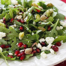 Arugula with Pomegranates, Blue Cheese and Pistachios
