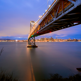 Bay Bridge by Jerome Obille - Buildings & Architecture Bridges & Suspended Structures ( lights, san francisco skyline, long ezposure, yerba buena island, blue hour in san francisco, city lights, ocean, bay bridge, cityscape, bay area, under the bridge )