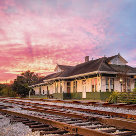 L&N Railroad at Sunrise by Stephen Marshall - Buildings & Architecture Public & Historical ( clouds, rails, railroad, depot, train, sunrise, tracks )