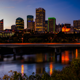 City Of Edmonton by Joseph Law - City,  Street & Park  Skylines ( building, blue sky, alberta, bushes, reflections, skylines, edmonton, saskachewan river, city )