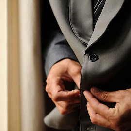 Groom getting ready by Leon James - Wedding Getting Ready ( jacket, hand, wedding day, wedding, lips, buttons, gray, groom, close up, man )