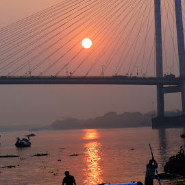 A boatman in the midst of dusk.. by Saumy Nagayach - Novices Only Objects & Still Life ( dawn, kolkata, india, bridge, boat, dusk )